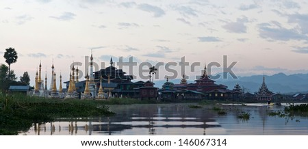 Ancient pagoda and monastery at sunrise on Inle lake, Shan state, Myanmar - stock photo