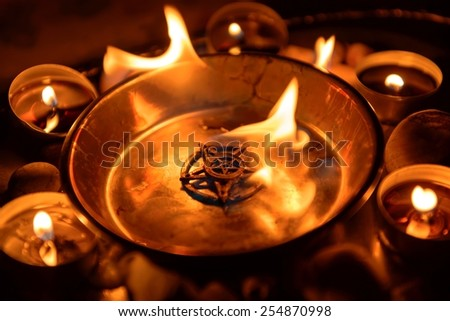 Ancient pentagram burning at altar close up - stock photo