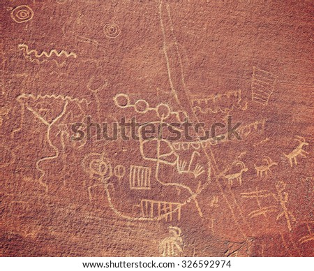 Ancient petroglyphs on rock in Valley of Fire State Park, Nevada, USA. - stock photo