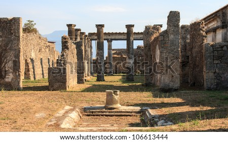 Ancient Pillars standing in the ruins on Pompeii, Italy - stock photo