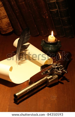 Ancient pistol near scroll and quill on wooden surface with lighting candle - stock photo