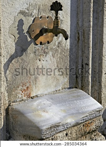 Ancient plumbing in Istanbul city. Really old source of water used by hundreds generation of people from Byzantine time till nowadays - stock photo