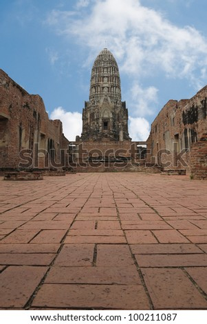 ancient prang in Ayutthaya, with blue sky