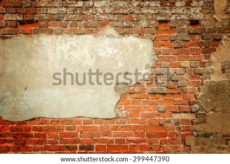 Ancient red brick wall background with cement. - stock photo