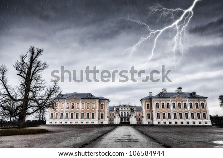 ancient residence and lightning - stock photo