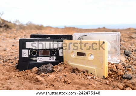 Ancient Retro Musicassette on the Sand in the Desert