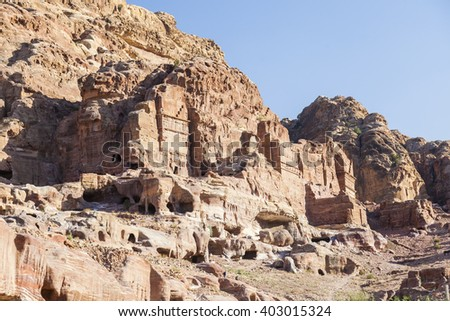 Ancient rock cut city in a deep valley, Petra. Jordan. - stock photo