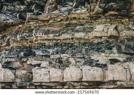 ancient rock layers closeup view - stock photo