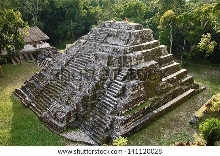 Ancient Rock Mayan Pyramid in Guatemala an Sunset - stock photo