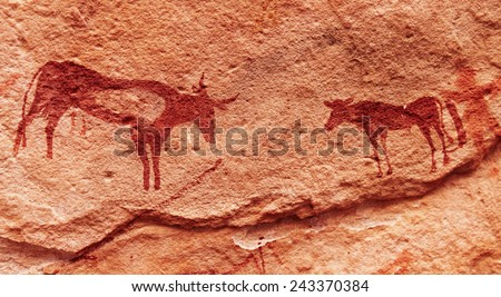 Ancient rock paintings in Sahara Desert, Tadrart, Algeria  - stock photo