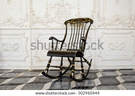 Ancient rocking chair - stock photo