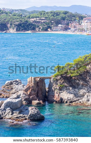 Ancient rocky bridge out in the sea in Lloret de mar, Girona, Catalonia, Spain
