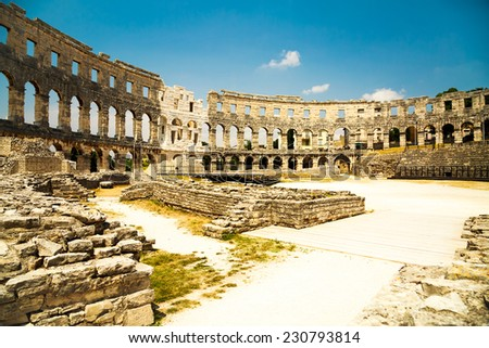 Ancient Roman Amphitheater in Pula, Croatia. Popular Touristic Destination of Istria at Adriatic Sea. Toned Photo. - stock photo