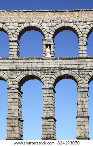 Ancient Roman aqueduct in Segovia, Spain - stock photo