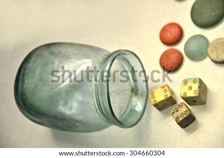 Ancient roman dice and shaker, with game counters - stock photo
