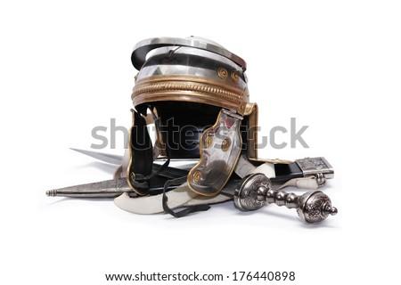 Ancient Roman military helmet near sword on white background - stock photo