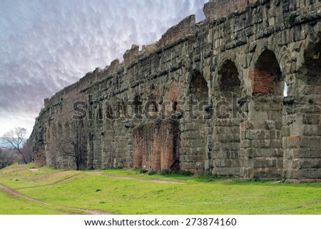 Ancient Roman ruins at the Parco degli Acquedotti, public park in Rome, Italy - stock photo