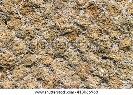 Ancient roman stone and brick wall, weathered and ruined, heritage of italian history. Beautiful background and texture, vintage or antique style.