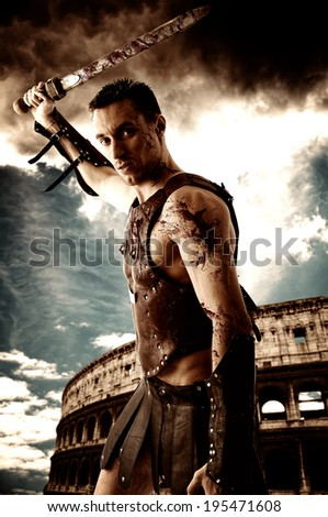 Ancient Rome warrior with sword on the Colosseum background - stock photo