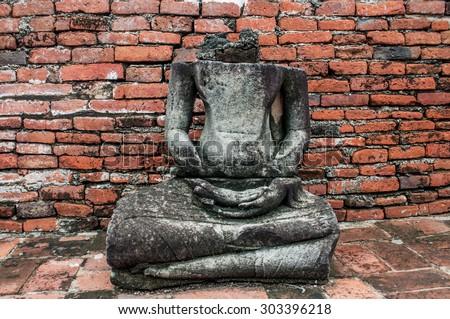 Ancient Ruin Stone Buddha Statue / Ancient Ruin Stone Buddha Statue in Ayutthaya Province, Thailand  - stock photo