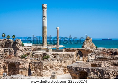Ancient ruins at Carthage, Tunisia with the Mediterranean Sea in the background - stock photo