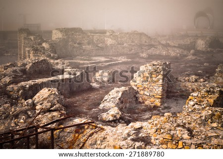 Ancient ruins in foggy morning, La Linea de la Concepcion, Spain. - stock photo