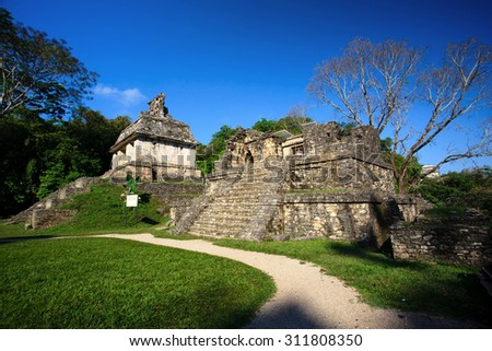 Ancient ruins in the Mayan city of Palenque Chiapas, Mexico. Sun Temple and Temple XIV. - stock photo