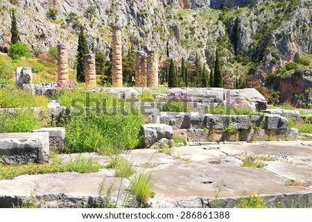 Ancient ruins inside the sanctuary of the Greek god Apollo, Delphi, Greece - stock photo