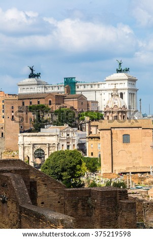 Ancient ruins of Forum and Victor Emmanuel II monument in a summer day in Rome, Italy - stock photo