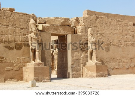 Ancient ruins of Karnak temple, statues of pharaohs on the pedestal, Luxor, Thebes, Egypt - stock photo