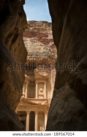 Ancient ruins of Petra Jordan. Narrow gorge to ancient city Petra, Jordan. The city of Petra was lost for over 1000 years but is now one of the new Seven Wonders of the World.