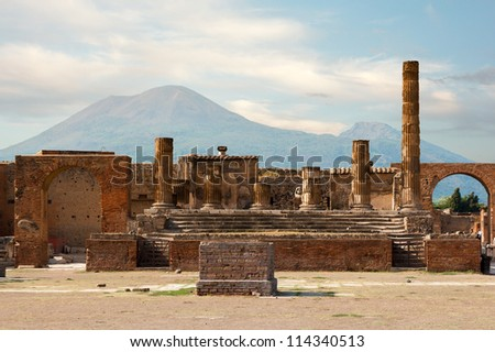 Ancient ruins of Pompei with volcano Vesuvius at back during sunset, Italy
