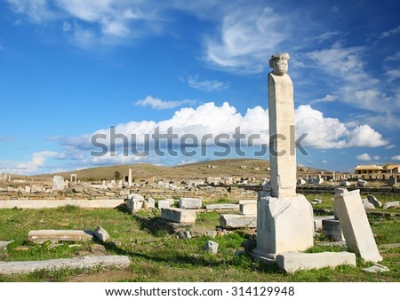 Ancient ruins on the island of Delos, of the coast of Greece. The archaeological site of Delos is on UNESCO World Heritage List since 1990. - stock photo