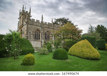 Ancient rural church in grounds, England