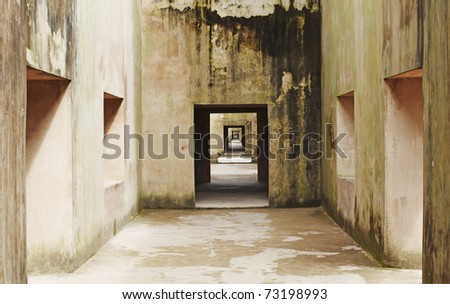 Ancient rustic room as crossroad for gateways into never ending hallways. - stock photo