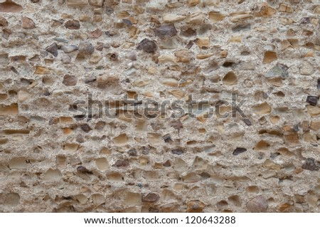 Ancient rustication is intended to backgrounds. This wall is from Carthage, Tunisia. - stock photo