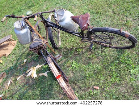 ancient rusty bicycles for the transport of milk in the bin of aluminum