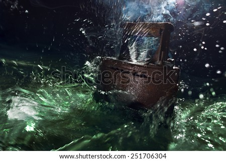 Ancient rusty iron iron (on charcoal) drowned in a sea of new technologies. - stock photo