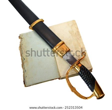 Ancient saber in black scabbard decorated with gold on antique shabby book with empty pages isolated on white - stock photo