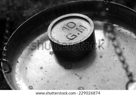Ancient scales with ten-gram mass, monochrome                                         - stock photo
