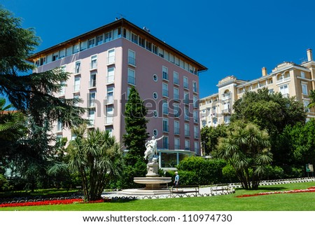 Ancient Sculpture and Beautiful Luxury Hotel in Optija, Croatia - stock photo