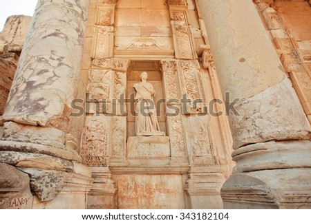 Ancient sculpture at entrance of historical Celsus Library of Ephesus city, Turkey. Greek city Ephesus founded on 10th century BC.   - stock photo