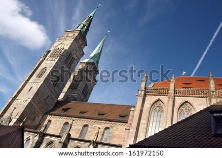 Ancient Sebaldus Kirche in Nuremberg with blue skies - stock photo