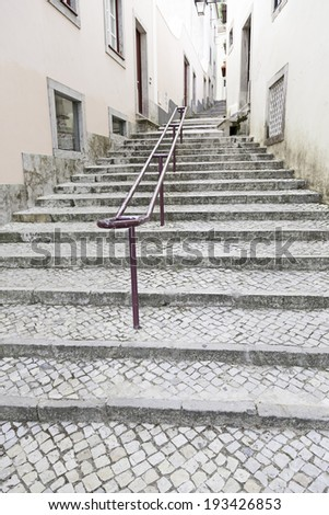 Ancient stairs on a street in Lisbon, detail of a stone staircase in an old street of Portugal