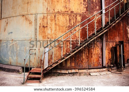 ancient stairway out side the rusty wall - stock photo