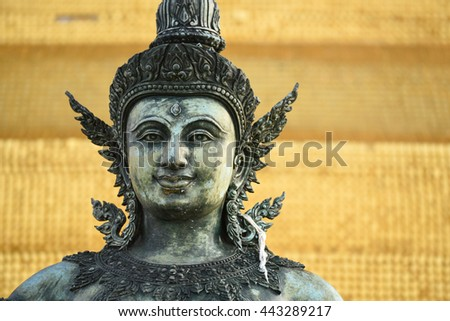 Ancient statue at the Top of Wat Saket (Phu Khao Thong) ,Temple of the Golden Mount