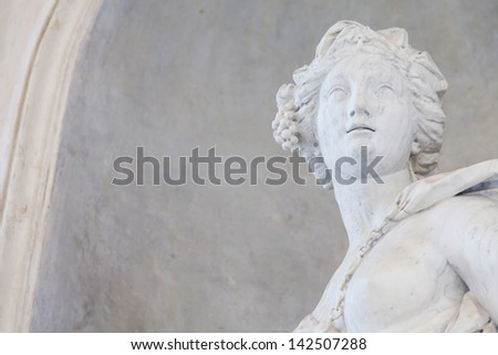 Ancient statue of a young woman in an Italian church close to Torino, north Italy