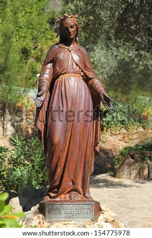 Ancient statue of the Virgin Mary in Ephesus, in front of her house  - stock photo