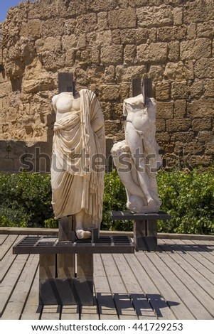 Ancient statues and marine artifacts in harbor of Caesarea National Park.Israel.Caesarea Maritima from 133 AD onwards, was a city and harbor built by Herod the Great about 25-13 BC.