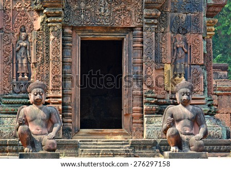 Ancient statues in Banteay Srei temple, Angkor Wat Complex, Siem Reap, Cambodia. - stock photo
